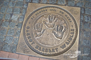 The hand prints of 1991 Le Mans winners Bertrand Gachot, Johnny Herbert and Volker Weidler