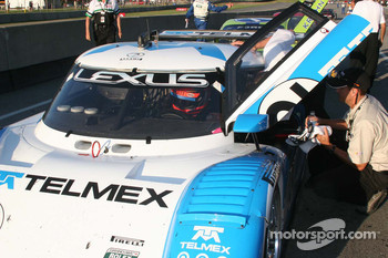 Race winner Scott Pruett prepares to exit the car