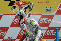 Podium: race winner Valentino Rossi, Fiat Yamaha Team celebrates 100th MotoGP win with Jorge Lorenzo, Fiat Yamaha Team