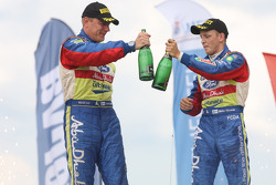 Podium: winners Mikko Hirvonen and Jarmo Lehtinen celebrate