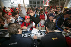 Fans get Giedo Van der Garde and Andreas Zuber autographs at the GP2 singing session