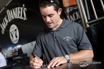 Casey Mears signs an autograph at the Jack Daniel's Experience