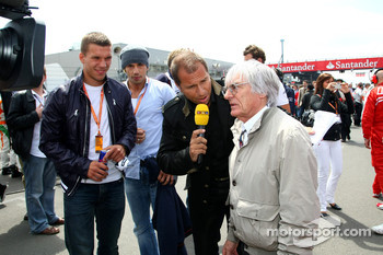 Lukas Podolski, Kai Ebel and Bernie Ecclestone, President and CEO of Formula One Management