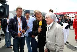 Lukas Podolski, Kai Ebel and Bernie Ecclestone, President and CEO of Formula One Management