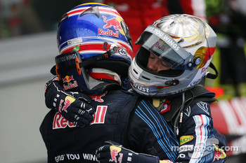 Race winner Mark Webber, Red Bull Racing celebrates with Sebastian Vettel, Red Bull Racing
