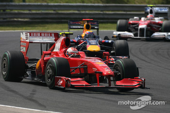 Kimi Raikkonen, Scuderia Ferrari and Mark Webber, Red Bull Racing