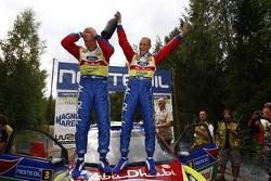 Rally winners Mikko Hirvonen and Jarmo Lehtinen celebrate