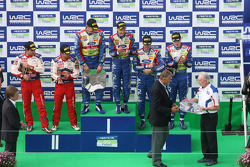 Podium: winners Mikko Hirvonen and Jarmo Lehtinen, second place Sébastien Loeb and Daniel Elena, third place Jari-Matti Latvala and Miikka Anttila and John Fleming who receives the  winning Manufacturer's trophy