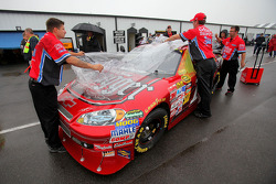 Crew members cover the #14 Old Spice Swagger Chevrolet