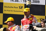 Podium: race winner Martin Tomczyk, Audi Sport Team Abt, second place Timo Scheider, Audi Sport Team Abt, third place Mattias Ekström, Audi Sport Team Abt celebrate with champagne