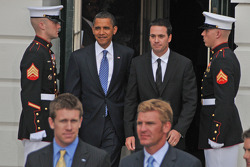 President Barack Obama and 2008 NASCAR Sprint Cup Series champion Jimmie Johnson emerge from the White House