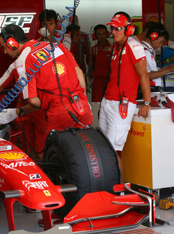 Michael Schumacher, Test Driver, Scuderia Ferrari in the garage with Luca Badoer, Test Driver, Scuderia Ferrari