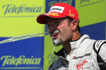 Podium: champagne celebration for race winner Rubens Barrichello