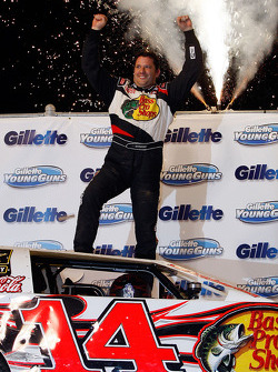 Tony Stewart, driver of the #14 celebrates after winning