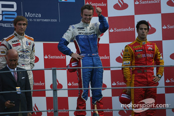 Podium: race winner Giedo Van der Garde, second place Vitaly Petrov, third place Lucas Di Grassi