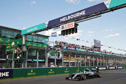 Race winner Nico Rosberg, Mercedes AMG F1 W07 takes the chequered flag at the end of the race