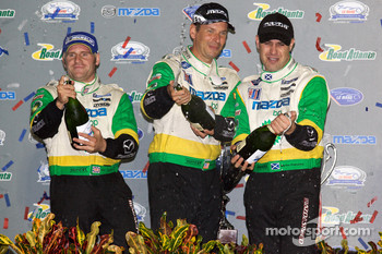 P2 podium: Butch Leitzinger, Marino Franchitti and Ben Devlin celebrate with champagne
