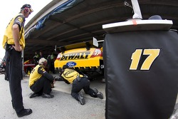 Crew members for the No. 17 Dewalt Ford work on their car