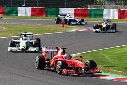 Kimi Raikkonen, Scuderia Ferrari leads Rubens Barrichello, BrawnGP