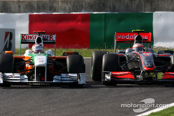 Adrian Sutil, Force India F1 Team, Heikki Kovalainen, McLaren Mercedes