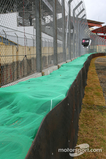 New fence and tyres barriers outside last corner