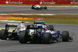 Kazuki Nakajima, Williams F1 Team and Jenson Button, Brawn GP