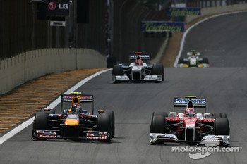 Sebastian Vettel, Red Bull Racing and Kamui Kobayashi, Toyota F1 Team