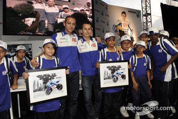 Visit of the Petronas Towers: Valentino Rossi and Jorge Lorenzo with young fans