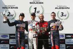 Robert Wickens, Andy Soucek, a mechanic and Mikhail Aleshin on the Championship podium