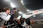 Final, race 3: Sebastian Vettel celebrates as Michael Schumacher wins the final race, while Jenson Button looks on