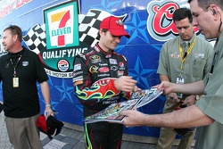 Jeff Gordon signs programs after winning the pole for the Dickies 500 at Texas Motor Speedway