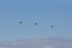 Three CH-53 Marine Corps helicopters from the HMH-361 Flying Tigers perform a flyover for the Able Body Labor 200 race