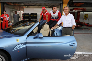 Luca di Montezemolo, Felipe Massa and Fernando Alonso after the drive around the track in a Ferrari California