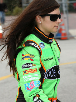 Danica Patrick, driver of the No. 88 JR Motorsports Chevy walks to her car