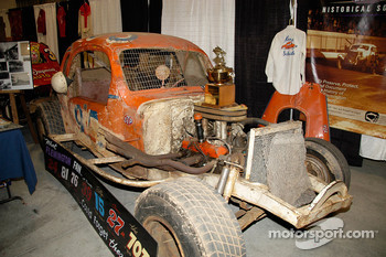The old race cars rarely stayed pretty by themselves.  We look forward to this one's restoration.