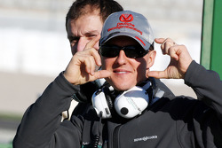Michael Schumacher, Mercedes GP pretends to take photos of the photographers