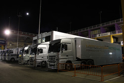 The Mercedes trucks in the paddock at night