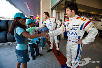 Giedo Van der Garde and Sergio Perez meet local Children visiting the GP2 Paddock