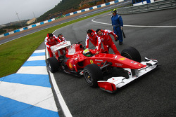 Felipe Massa, Scuderia Ferrari getting pushed back to the garage after stopping on the track
