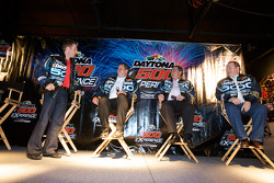 Champion's breakfast: 2010 Daytona 500 winner Jamie McMurray with team owners Chip Ganassi and Felix Sabates, and crew chief Kevin Manion talk with fans
