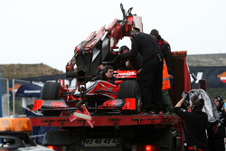 Timo Glock, Virgin Racing VR-01, car is returned to the pits