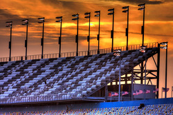 The sun sets on the frontstretch grandstands