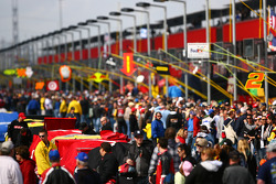 Fans walk pit lane prior to the start