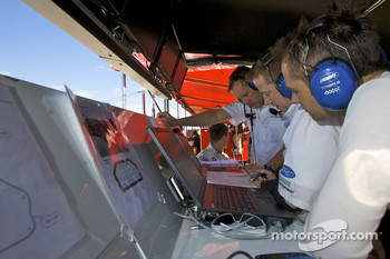 Andy Priaulx and BMW Rahal Letterman Racing team members look at data