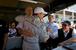 GT2 pole winner Dirk Muller celebrates with Bobby Rahal