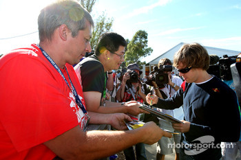 Sebastian Vettel, Red Bull Racing, signs autographs