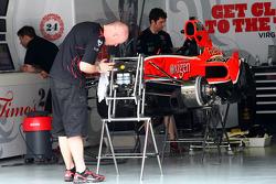 The Virgin Team work on their cars