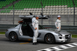 Michael Schumacher, Mercedes GP and Nico Rosberg, Mercedes GP with the safety car