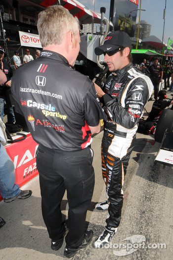 Alex Tagliani talking with a crew member
