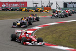 Fernando Alonso, Scuderia Ferrari leads Mark Webber, Red Bull Racing at the start of the race